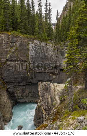 Waterfall in early summer in the Rocky Mountains - Banff National Park, Alberta, Canada - stock photo