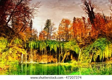 waterfall in forest, autumn with wide angle lens - stock photo