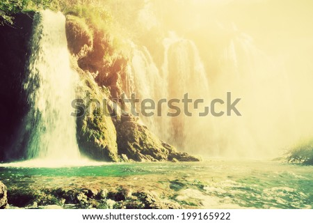 Waterfall in forest. Crystal clear water. Plitvice lakes, Croatia. Vintage, retro style - stock photo