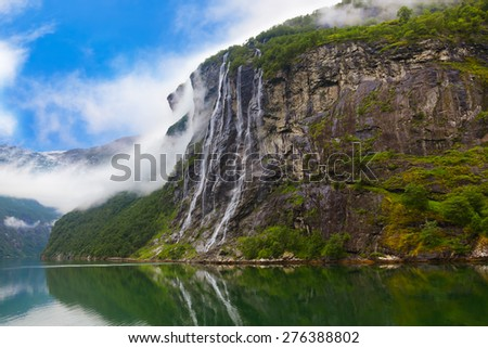 Waterfall in Geiranger fjord Norway - nature and travel background - stock photo