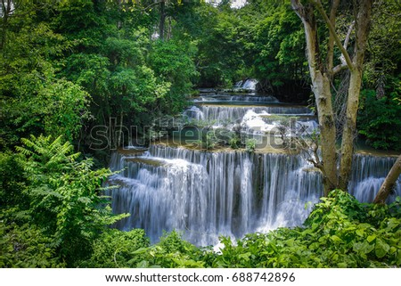 waterfall in green forest on sunrise  morning.