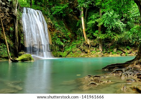 Waterfall in Green Forests - stock photo