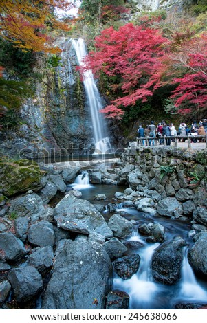 Waterfall in Minoo Park, Japan 27 Nov 2014: Group of Tourist taking photo on waterfall in autumn season at Minoo Park, Osaka, Japan - stock photo