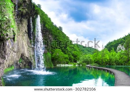 waterfall in mountain lake and green park. Croatia. - stock photo