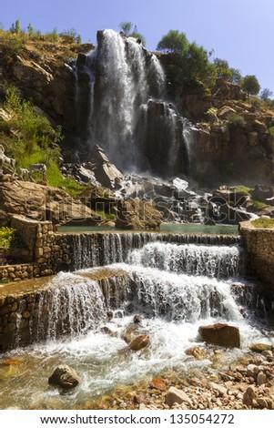 Waterfall in mountains in Tagob, Tajikistan - stock photo