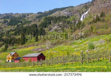 waterfall in Norway. mountain landscape in early spring - stock photo