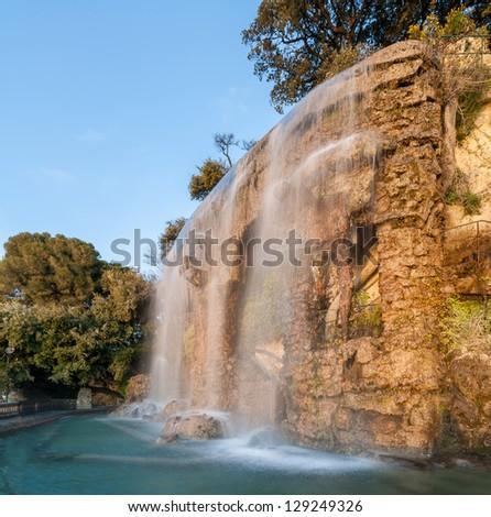 Waterfall in Parc de la Colline du Chateau - Nice, France - stock photo
