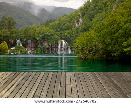 Waterfall in Plitvice lake and wooden plank, Croatia. - stock photo