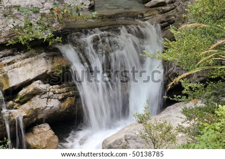 Waterfall in Pyrenees mountains with long exposition time