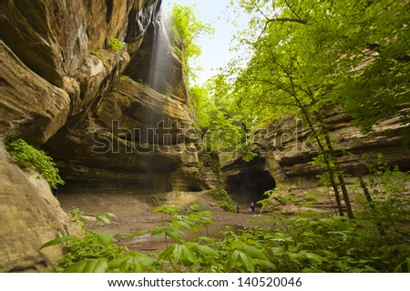 Waterfall in rocky canyon - stock photo