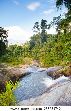 Waterfall in Thailand in tropical forest - stock photo