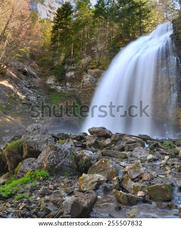 waterfall in the forest jumping on rocks with effects - stock photo