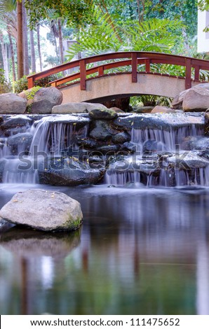 Waterfall in the gaden - stock photo