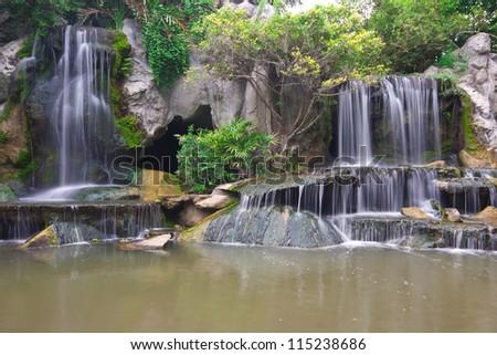 Waterfall In The Garden - stock photo