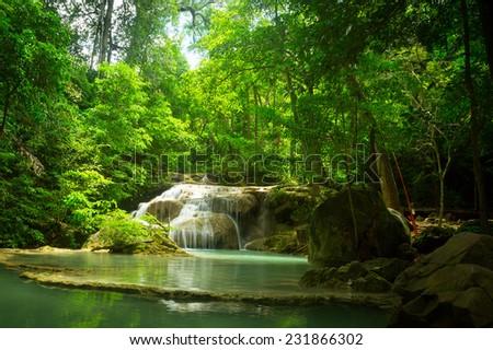 Waterfall in the jungle. Green lake. - stock photo