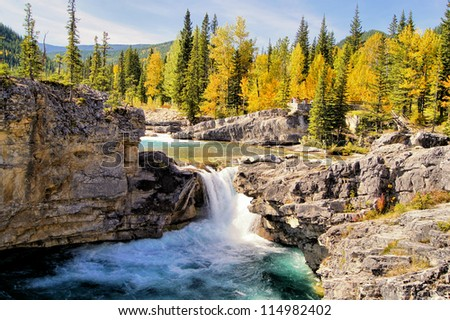 Waterfall in the Kananaskis region of the Canadian Rockies during autumn - stock photo