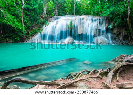 Waterfall in the tropical forest at Erawan National Park - stock photo