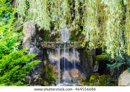 Waterfall in the wild nature on the long exposition