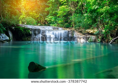 Waterfall in tropical forest at Erawan waterfall National Park, Thailand  - stock photo