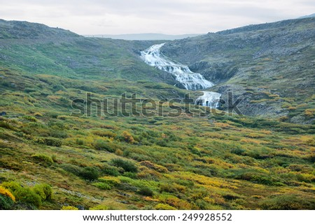 Waterfall in Westfjords, Iceland - stock photo