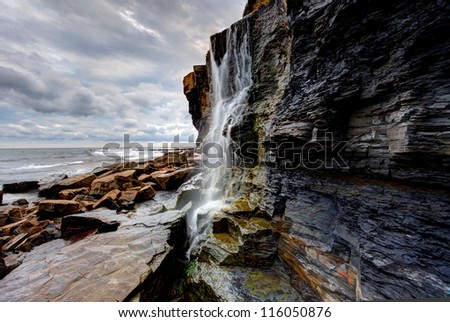 Waterfall landscape and seascape on the southern British coast - stock photo