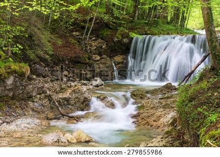 Waterfall near Bergen with fresh green leaves, Bergen, Bavaria, Germany - stock photo