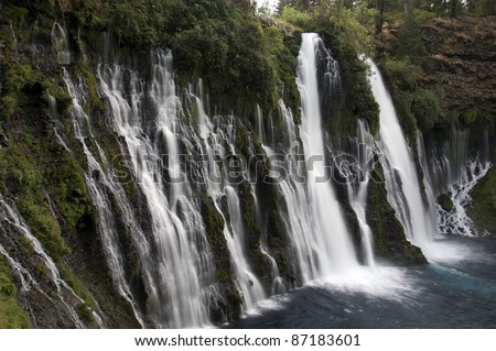 Waterfall: Northern California's majestic Burney Falls in the dim light of morning. - stock photo