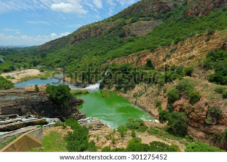 Waterfall of Crocodile River Hartbeespoort Dam in South Africa - stock photo
