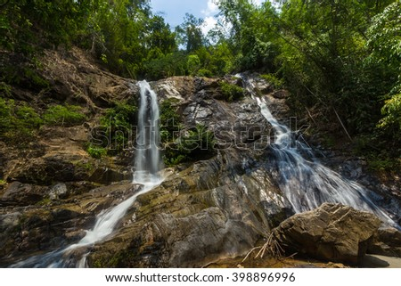 Waterfall on a mountain river. - stock photo