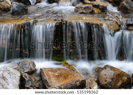 Waterfall on a small mountain stream in winter