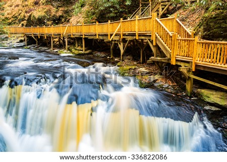 Waterfall on Little Bushkill creek. Wooden footpaths border the river. Little Bushkill Creek is a tributary of the Delaware River in eastern Pennsylvania - stock photo