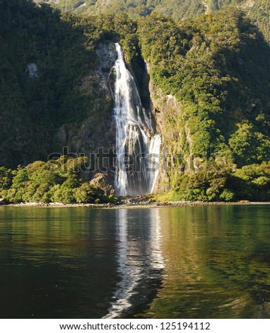 Waterfall on Milford Sound, New Zealand - stock photo