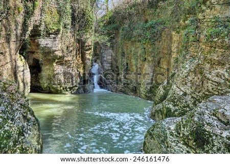 Waterfall on the river Agura in Agursky gorge on the territory of the Khosta district of Sochi in Krasnodar Krai of Russia - stock photo