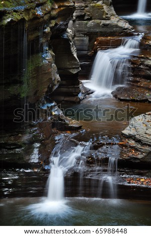 waterfall over rocks and stream in Watkins Glen state park in New York State - stock photo