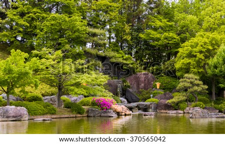 Waterfall, Pond, Reflection, green Colors, Japanese garden - stock photo