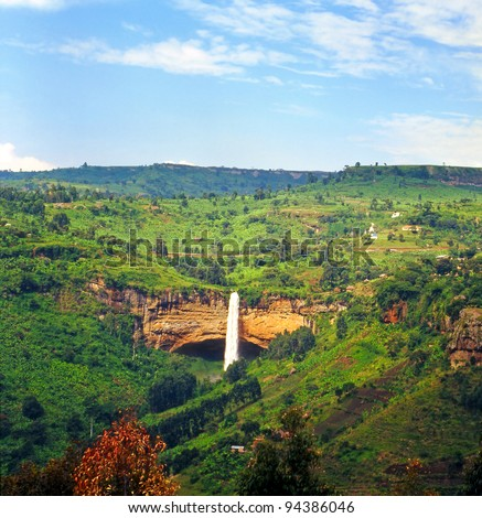 Waterfall Sipi Falls is a series of three waterfalls in Eastern Uganda in the district of Kapchorwa, northeast of Sironko and Mbale. The waterfalls lie on the edge of Mount Elgon National Park - stock photo