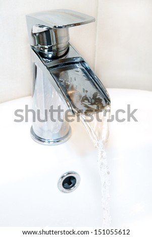 Waterfall tap or faucet - stock photo
