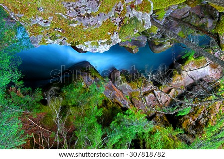 Waterfall through a narrow gorge of Avalanche Creek in Glacier National Park Montana - stock photo