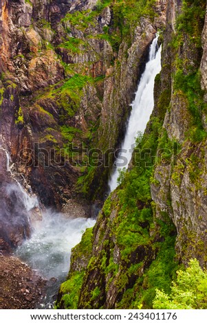 Waterfall Voringfossen in Hardanger Norway - nature and travel background - stock photo