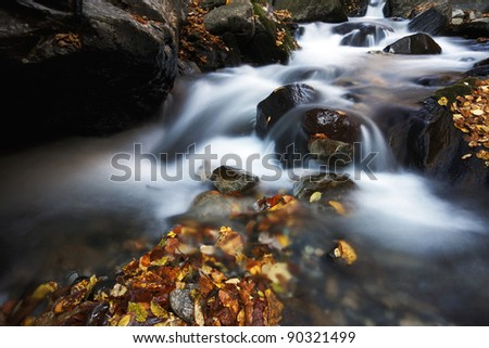 waterfall with autumns colors - stock photo