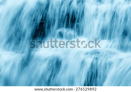 waterfall with soft water on the rocks - stock photo