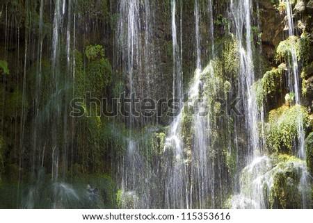 Waterfalls at Argiroupoli springs in Crete island, Greece. Area of Lappa - stock photo