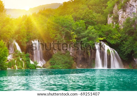 Waterfalls in national park in sun rays. Plitvice, Croatia - stock photo