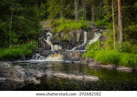 waterfalls in the forest, karelia, ruskeala - stock photo