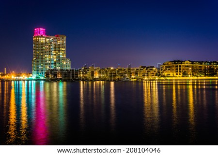 Waterfront condominiums at the Inner Harbor at night, seen from Harbor East, Baltimore, Maryland. - stock photo