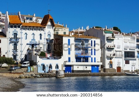 Waterfront houses in the Mediterranean village of Cadaques, Spain, Costa Brava, Catalonia - stock photo