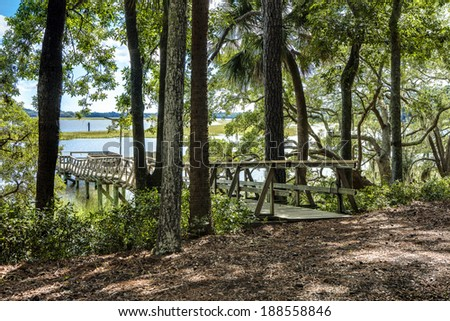 waterfront property with natural wood setting and dock - stock photo