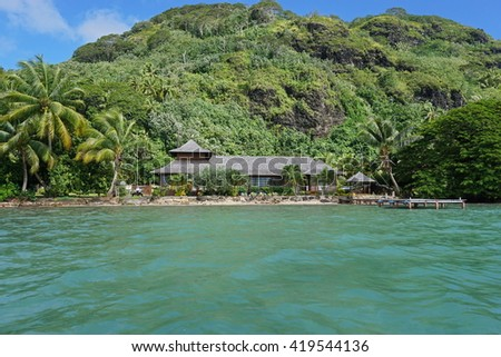 Waterfront property with tropical home and green vegetation, Huahine island, Pacific ocean, Society islands, French Polynesia - stock photo