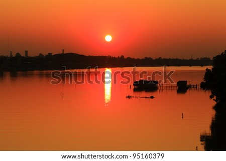 Waterfront restaurant in the evening. - stock photo