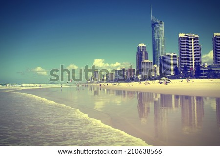 Waterfront skyline with famous Q1 skyscraper - Surfers Paradise city in Gold Coast region of Queensland, Australia. Cross processed color tone - retro filtered style. - stock photo